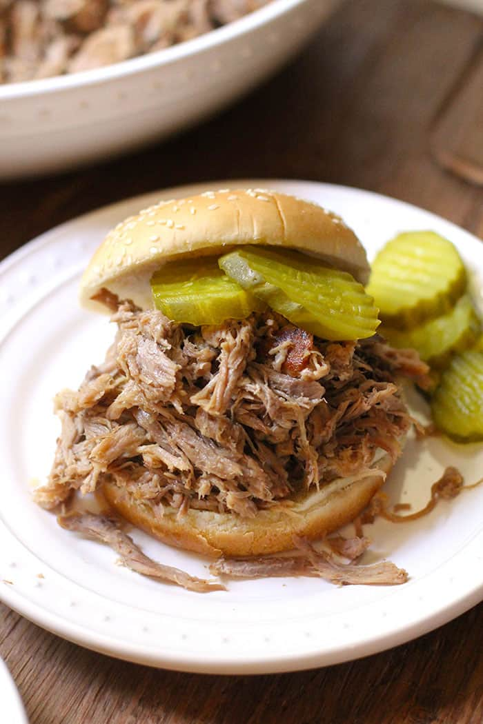 Slow Baked Pulled Pork is the perfect main course for holiday entertaining or as a game day staple. Only 15 minutes of prep and then 12 hours in the oven! | suebeehomemaker.com