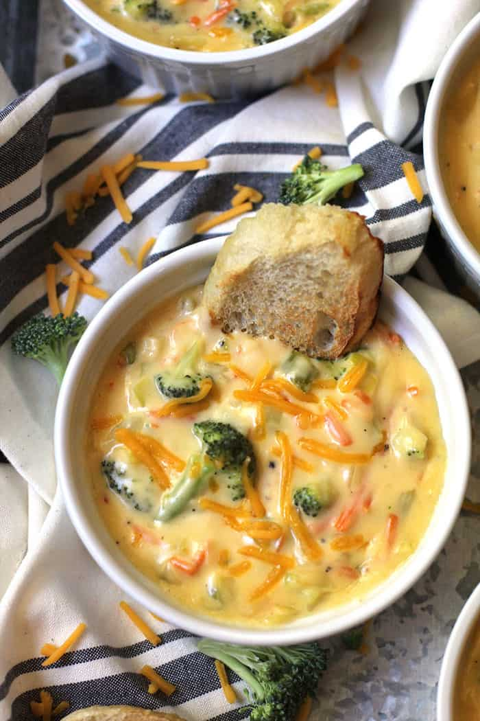 Creamy Broccoli Cheddar Soup is total comfort food. A vegetable base with a creamy roux makes this soup a stretchy-waistband, cozy day meal! | suebeehomemaker.com