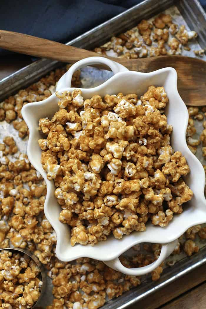 Easy Caramel Popcorn is a perfect snack for any time of year. Baking it in the oven makes it nice and crunchy. Watch out because it's delicious & addicting!