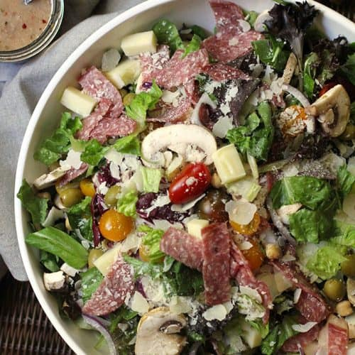 Making a large interesting Italian Chopped Salad at the start of the week will encourage healthy eating all week long. My Creamy Italian Dressing is a must! | suebeehomemaker.com