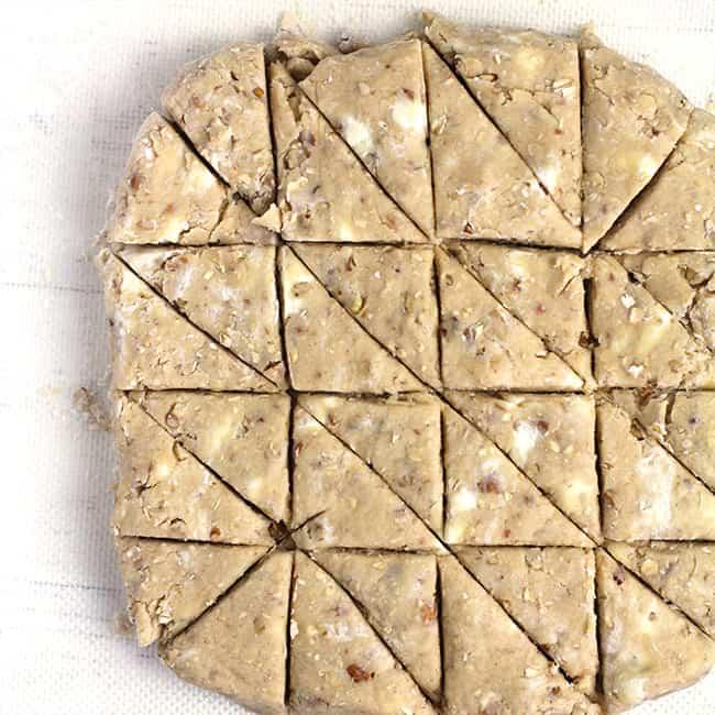 Overhead shot of the scone dough, cut into 23 triangles.