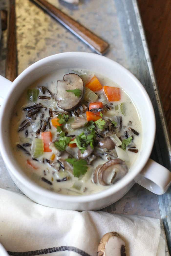 Creamy Wild Rice Soup with Mushrooms has all the good stuff - plenty of veggies, wild rice, and a creamy roux to bring it all together! | suebeehomemaker.com