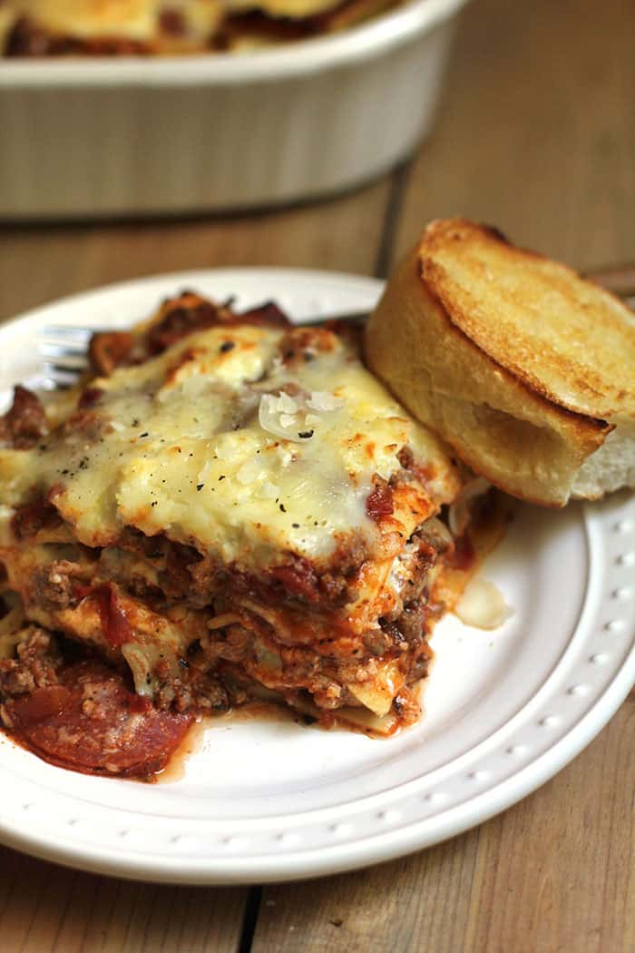 Meat Lover's Lasagna is a go-to meal for hungry families. It's hearty with three kinds of meat and three kinds of cheese, and fills you up! | suebeehomemaker.com