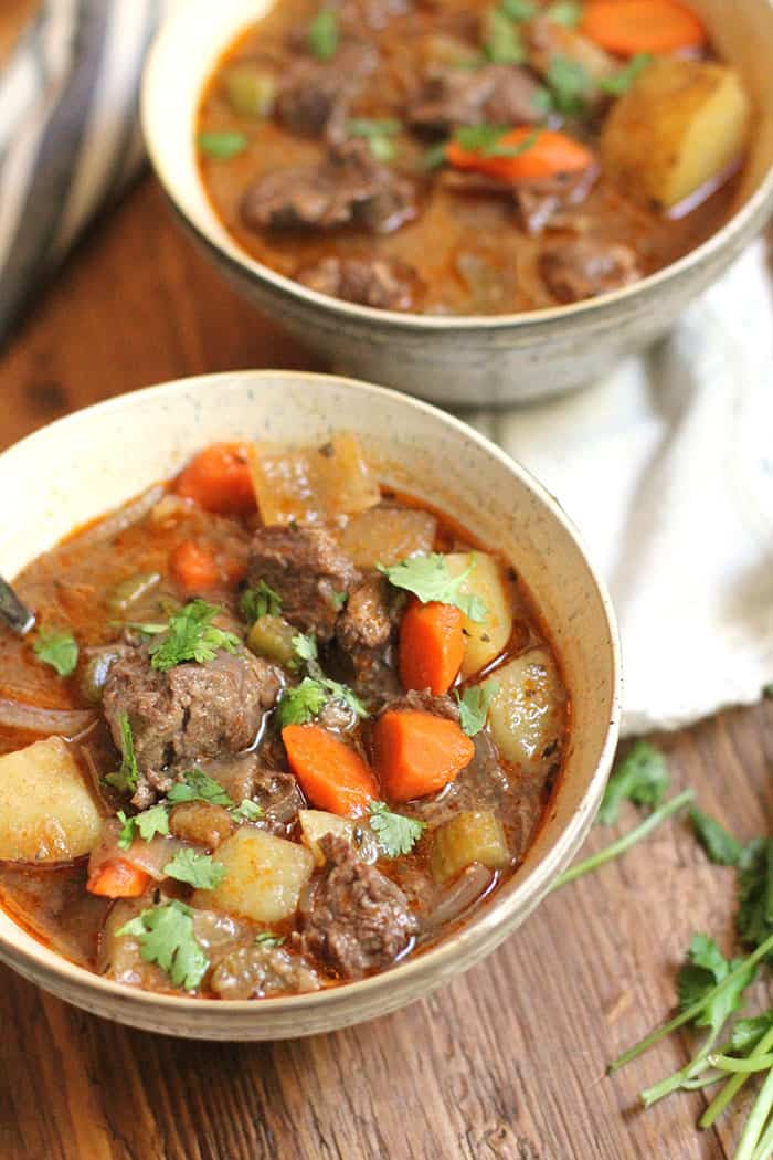 Slow Cooker Beef Stew is a winter weather dream meal. Throw everything in your crock pot and come home to a warm bowl of deliciousness! | suebeehomemaker.com