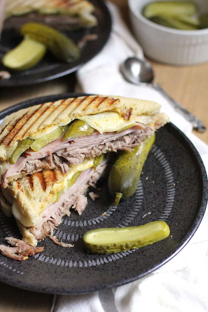 My Classic Cuban Sandwich combines pulled pork roast, deli ham, Swiss cheese, dill pickles, and mustard - all piled high on top of crusty bread of your choice. A great sandwich for hungry peeps! | suebeehomemaker.com