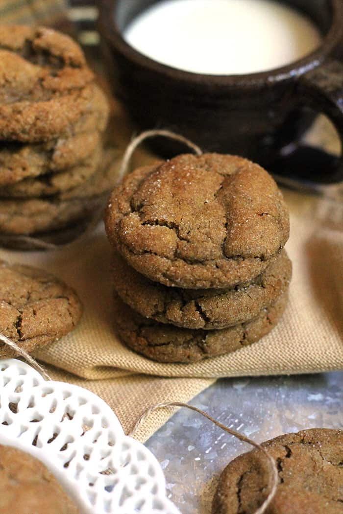 Overhead shot of a stack of cookies next to a brown homemade mug with milk.