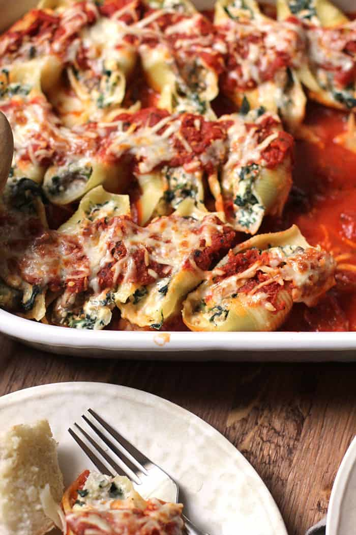 A close up on a partially eaten casserole of turkey sausage stuffed shells.