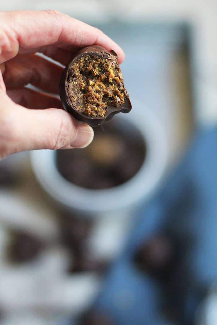 Dark Chocolate Covered Energy Bites are another spin on my original Peanut Butter Power Balls. I love the healthy nut and date center topped with a dark chocolate coating. Win/Win for balance! | suebeehomemaker.com