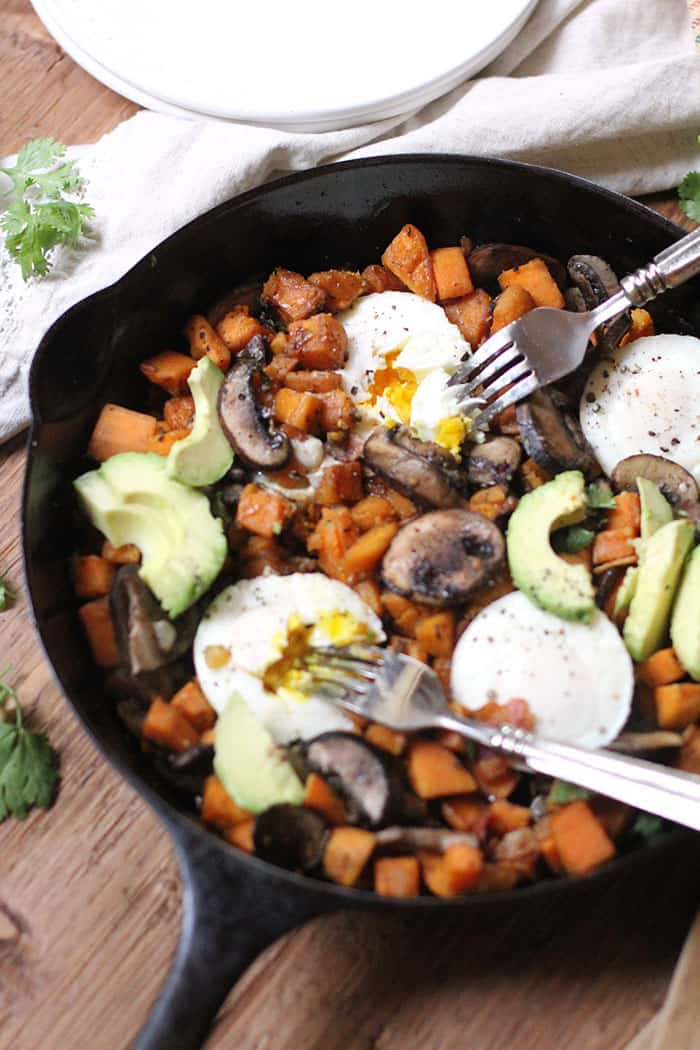 Weekend mode now includes this Sweet Potato Breakfast Hash. Poached eggs, sweet potatoes, bacon, mushrooms, and avocados are my answer to a perfect lazy brunch! | suebeehomemaker.com