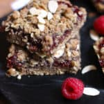 Raspberry Almond Breakfast Bars are THE breakfast bar of choice after this simple creation. An oatmeal almond chewy layer on the bottom and top, with a simple raspberry spread in the middle! | suebeehomemaker.com