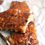 Barbecue Baby Back Ribs are a meat lover's dream. Marinate them overnight, slow roast them in the oven, and then finish them off on the grill for that smokey, barbecue taste! | suebeehomemaker.com
