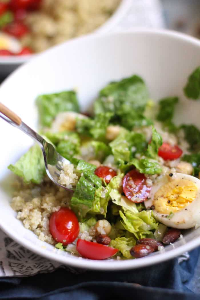 Protein Packed Quinoa Salad is everything you need in one bowl to survive a grueling day. Loaded with healthy greens, and plenty of protein packed super-foods, this salad is incredibly tasty too! | suebeehomemaker.com
