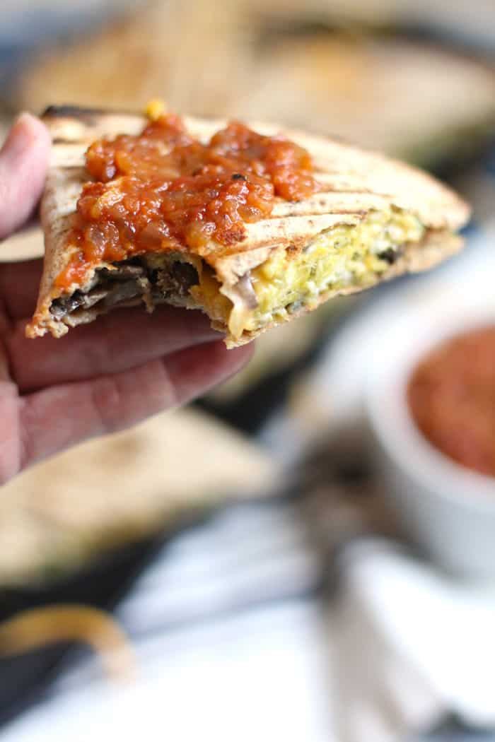 Simple and healthy, these Veggie Omelette Quesadillas are stuffed full of eggs, veggies, and cheese! Eat them plain or top them with salsa and avocado slices. | suebeehomemaker.com