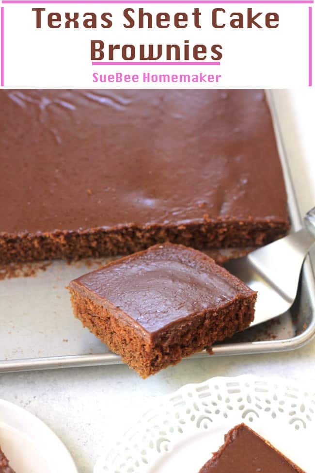 A sheet pan of Texas sheet cake brownies, with one brownie on a serving tool.