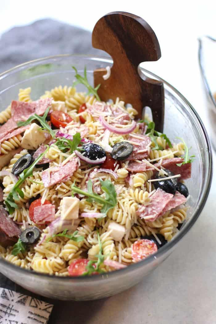A bowl of Best Italian Pasta Salad with a wooden utensil.
