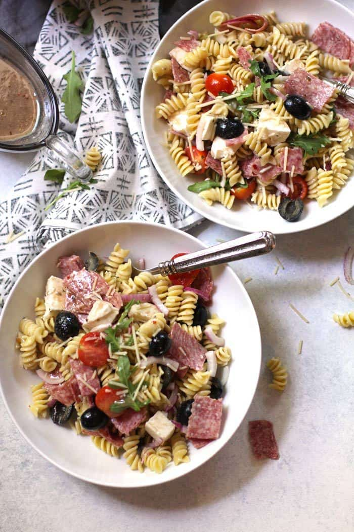 Best Italian Pasta Salad combines Italian flavors with rotini pasta and a creamy Italian dressing. The flavors of this simple pasta salad get better as it sits! | suebeehomemaker