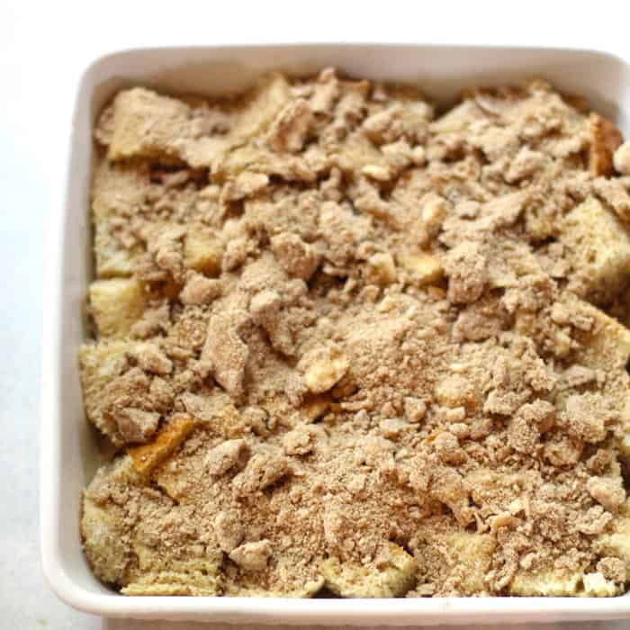 Overhead close-up shot of French toast casserole before baking - in a square white dish.