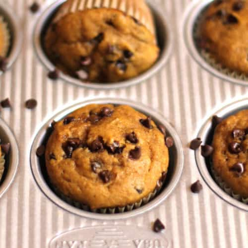 Close-up shot of muffins in tin, with one turned sideways.