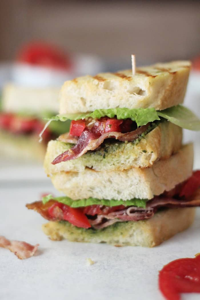 Try this BLT Sandwich with Pesto Sauce for your next easy weeknight dinner. Having home grown tomatoes makes this sandwich even better! | suebeehomemaker.com