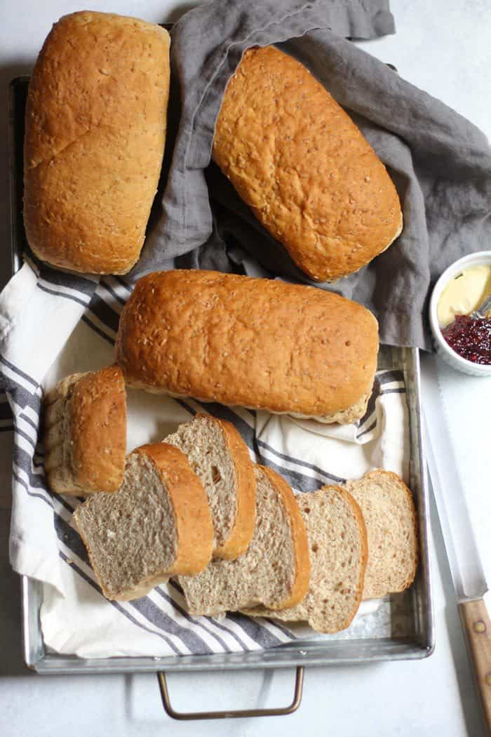 Cracked Wheat Bread is a hearty, nutty bread and loaded with oatmeal, whole wheat, cracked wheat, and honey. Perfect for toasting with a small pat of butter and jam! | suebeehomemaker.com