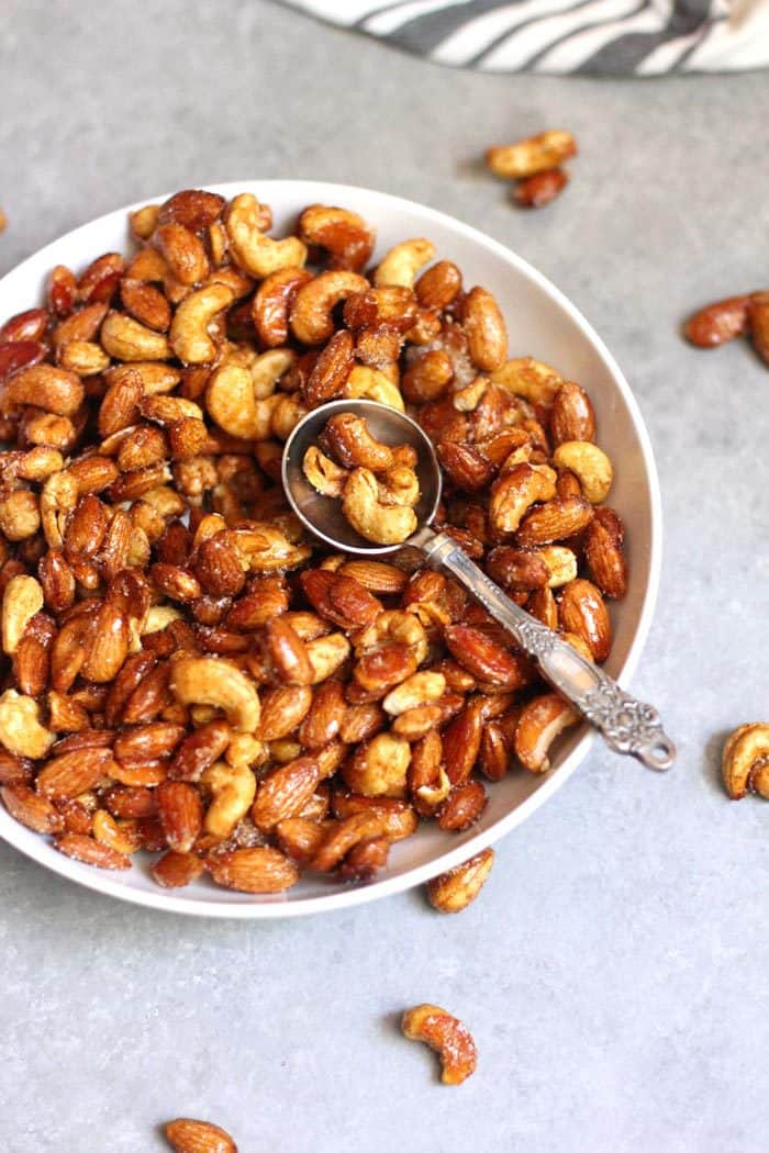 Honey Roasted Nuts are a simple mixture of nuts, honey, a few spices, and a little bit of sugar. Just 15 minutes in the oven, and serve them warm or cold! | suebeehomemaker.com