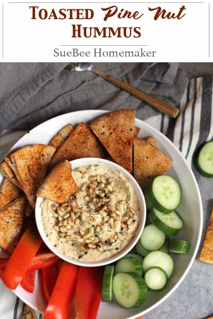 Toasted Pine Nut Hummus combines my favorite nut with garbanzo beans, tahini paste, garlic, lemon, and spices. Taking the skin off the garbanzo beans is worth the time because it gets really creamy. SO good, and healthy too! | suebeehomemaker.com| #pinenuthummus #hummus #toastedpinenuts #dipandveggies #pitachips