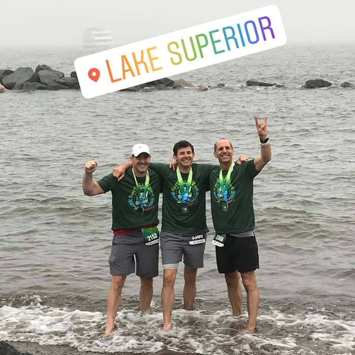 The three brothers celebrated after finishing Grandma's Marathon.