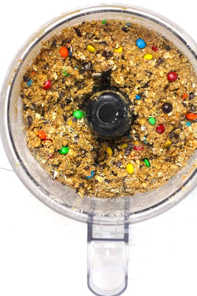 Overhead shot of a food processor filled with oatmeal ball mixture.