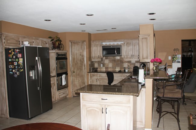 Before picture of our kitchen, with lower ceilings and brown cabinets.