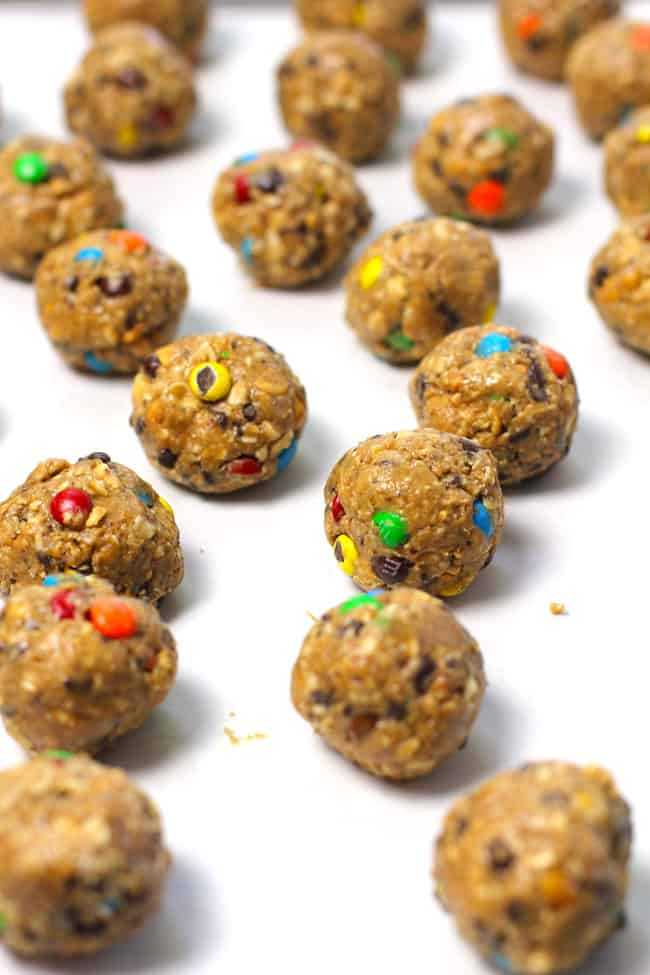 Side shot of a bunch of peanut butter oatmeal balls before being dipped in chocolate.