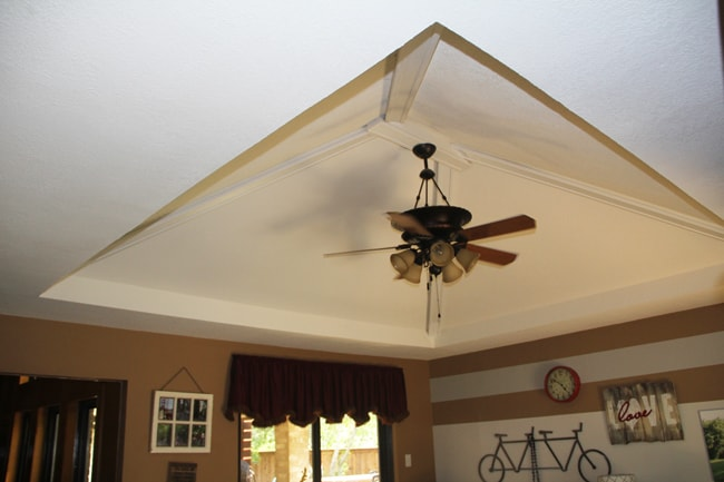 Before picture of ceiling above sunroom.