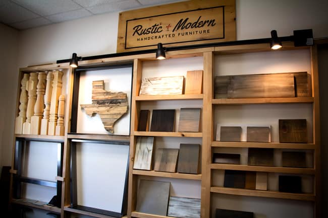 Picture of Rustic and Modern office wall, with wood samples on shelves.