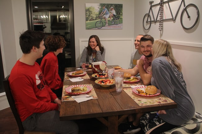 Picture of the family eating dinner at the farmhouse table.
