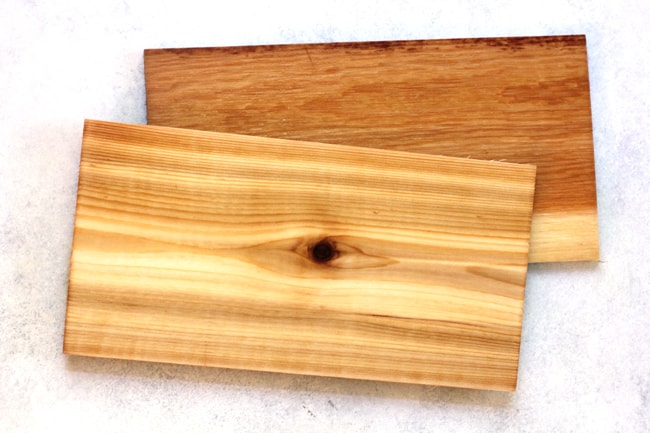Overhead shot of two cedar planks, on a white background.