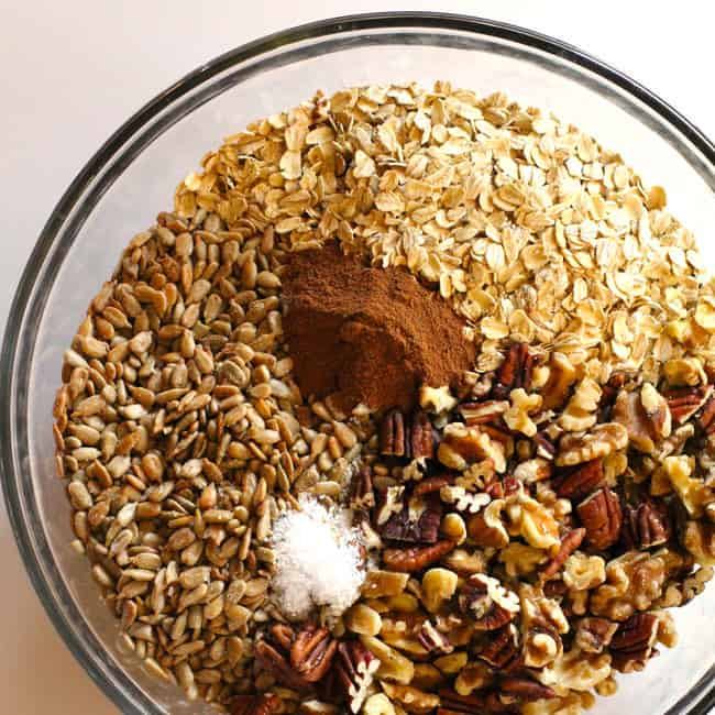 Overhead shot of a large glass bowl of the dry granola ingredients.