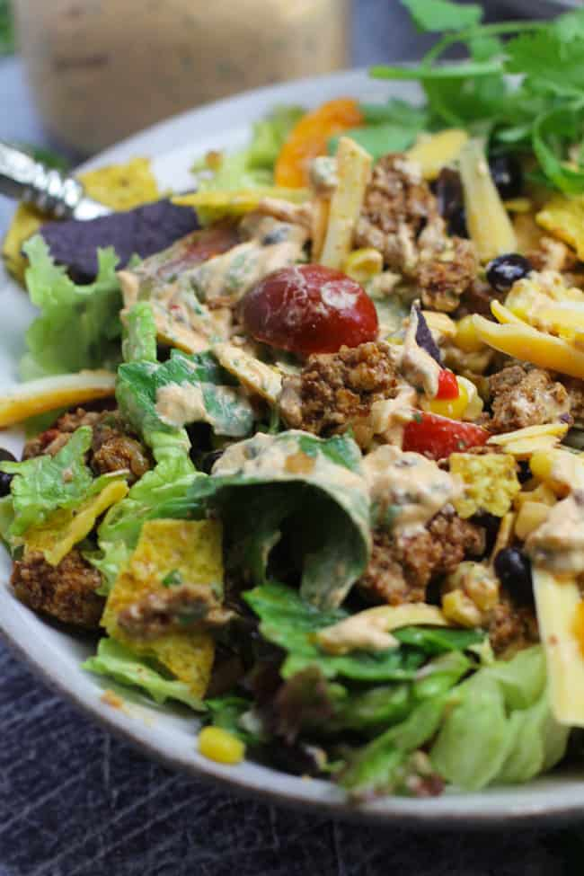 Closeup shot of a healthy taco salad, with chipotle dressing.
