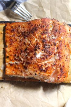 Overhead shot of Cedar Plank Salmon on brown parchment paper.