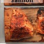 Closeup on a piece of grilled salmon on a cedar plank.
