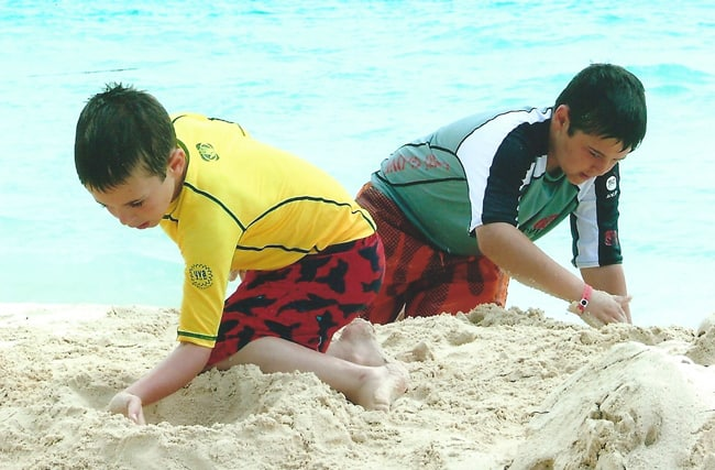 Josh and Zach making sandcastles in Cancun, Mexico.