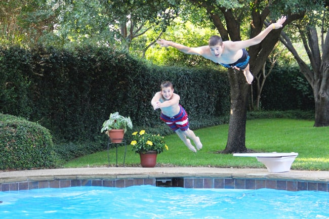 Josh and Zach diving off into the pool.