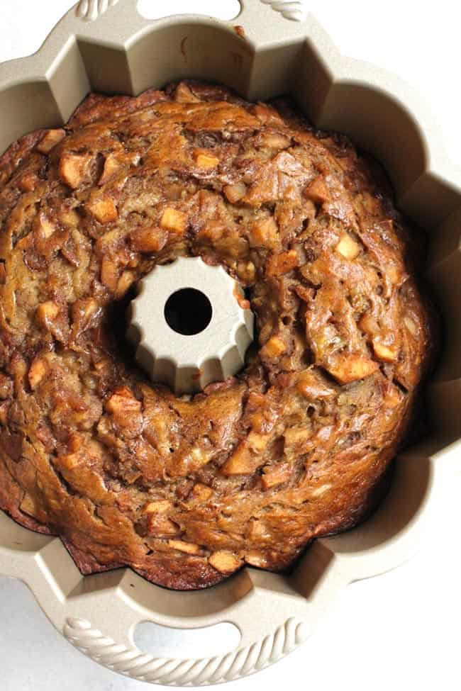 Overhead shot of an apple pie banana bundt cake, in a bundt pan.
