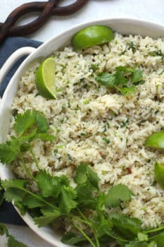 Overhead shot of a white bowl with handles, full of instant pot cilantro lime rice.