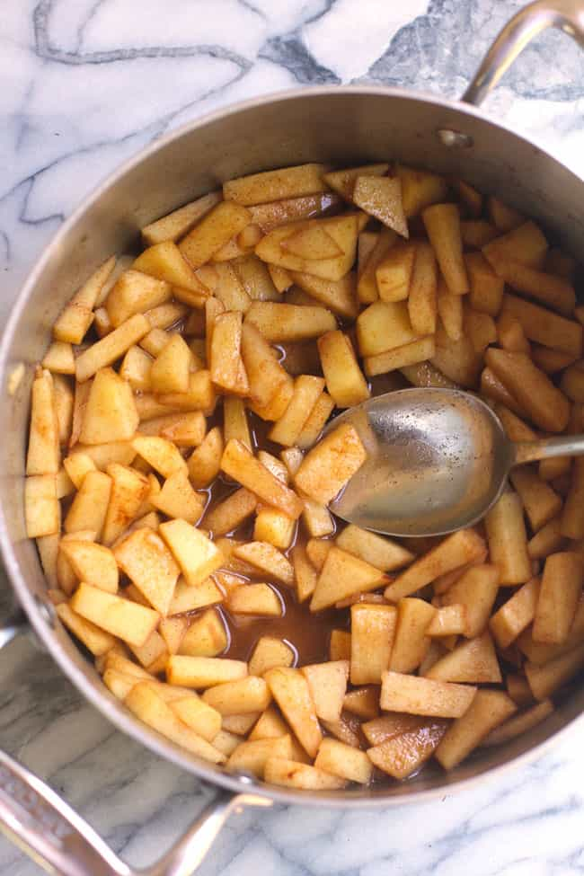 Overhead shot of a pan of cooked cinnamon apples.