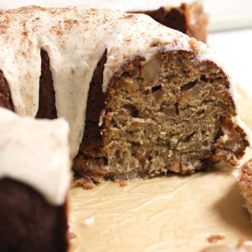 Side shot of a partial apple pie banana bundt cake, showing the texture inside the cake.