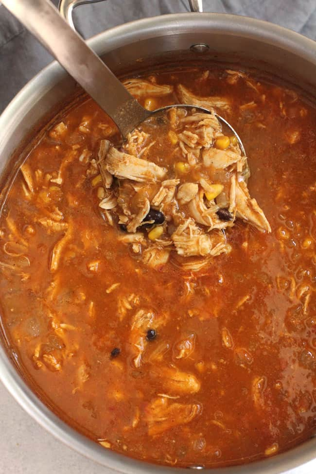 A pan full of the best chicken tortilla soup.