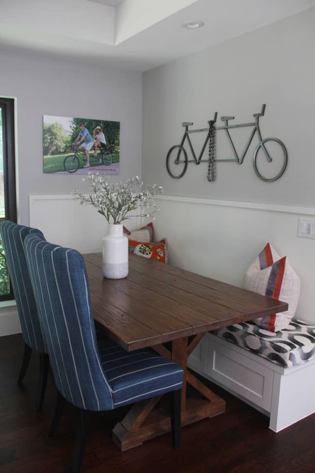 Another angle of the farmhouse table with the iron bike above it.