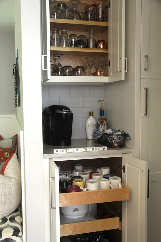 The drawers and cabinets open above and under the coffee bar.