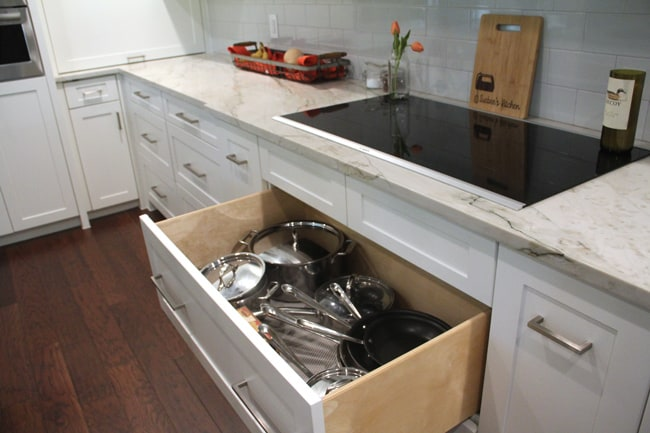 The open drawer showing pots and pans.