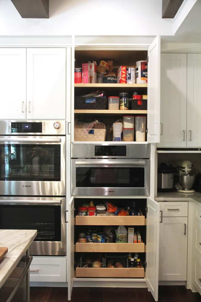 Open pantry over and under microwave.