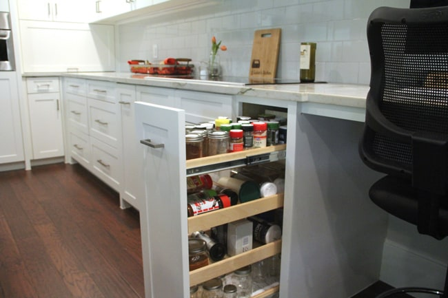 Open spice drawers by stove.